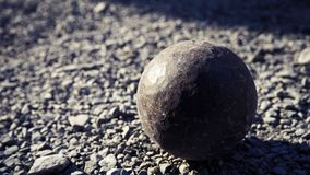 Old petanque balls on the ground. Steel ball on the ground. Light and shadow. Old petanque balls on the ground. Steel ball on the ground. Light and shadow stock photo