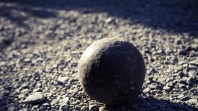 Old petanque balls on the ground. Steel ball on the ground. Light and shadow. Old petanque balls on the ground. Steel ball on the ground. Light and shadow stock photos