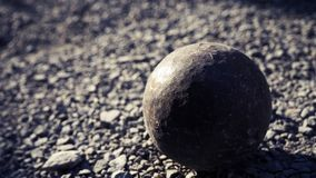 Old petanque balls on the ground. Steel ball on the ground. Light and shadow. Old petanque balls on the ground. Steel ball on the ground. Light and shadow stock photography