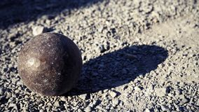 Old petanque balls on the ground. Steel ball on the ground. Light and shadow. Old petanque balls on the ground. Steel ball on the ground. Light and shadow royalty free stock photos