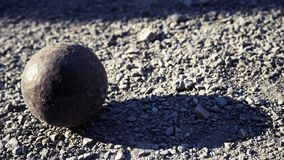 Old petanque balls on the ground. Steel ball on the ground. Light and shadow. Old petanque balls on the ground. Steel ball on the ground. Light and shadow stock images