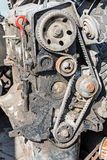 Old petrol engine. Worn out engine of gasoline with the removed timing gear cover stock image