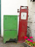 Old petrol pump. Old garage work cabinet with petrol pump and bicycle UK Royalty Free Stock Photo