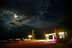 Old petrol station by night Stock Image