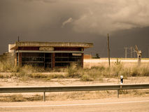 Old petrol station on storm day. Gas station road desused on spanish countryside Royalty Free Stock Photos