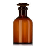 Old pharmacy bottle for medicines isolated on white Royalty Free Stock Photos