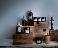 Old pharmacy. bottles, jars, candle on wooden shelves Stock Image