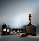 Old pharmacy. bottles, jars, candle on wooden shelves Stock Images