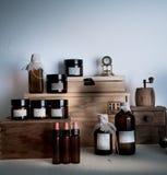 Old pharmacy. bottles, jars, clock on wooden shelves Royalty Free Stock Photography