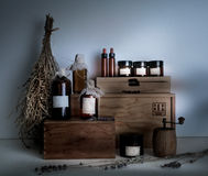 Old pharmacy. bottles, jars, dried wormwood bouquet on wooden shelves Royalty Free Stock Photo