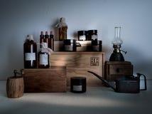 Old pharmacy. bottles, jars, scales, a kerosene lamp on wooden shelves Royalty Free Stock Photos