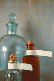 Old pharmacy bottles with labels Stock Images