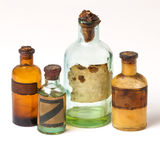 The old pharmacy bottles. With paper labels on a white background royalty free stock image