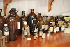 Old pharmacy detail. Old pharmacy with many glass bottles stock photography