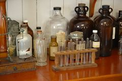 Old pharmacy detail. Old pharmacy with many glass bottles stock photos