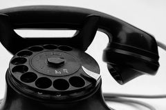 Old phone. Old-fashioned antique phone has a little dirty and worn royalty free stock photography