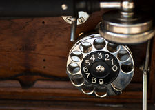 Old phone. Dialer and wood details of an old phone stock photos
