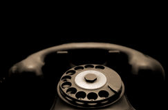 Old phone. Classic, black, rusty and dusty telephone Royalty Free Stock Images