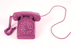 Old Phone. A colorful old phone in front of white background Royalty Free Stock Photo
