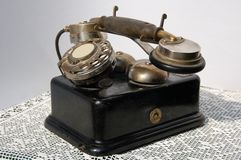 Old phone. First type of phone, which has a dialing mechanism stock photo