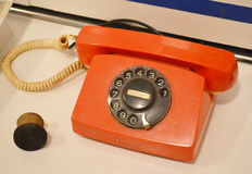 Old phone. The photo of big retro red phone Stock Photo