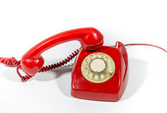 Old Phone. It is an old red phone on a white background royalty free stock photos