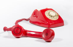 Old Phone. It is an old red phone on a white background stock photography
