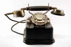 Old phone. First type of phone, which has a dialing mechanism royalty free stock photo