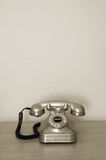 Old phone. Old antique phone on a night stand Royalty Free Stock Photography