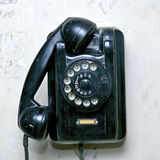 Old phone. On a durty background Royalty Free Stock Image