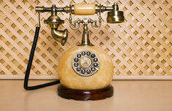 Old phone. Vintage telephone on a wooden background Royalty Free Stock Image