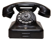 Old phone. Old-fashioned antique phone with dialplate isolated on white Royalty Free Stock Image