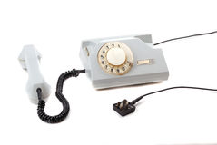 OLD phone. Of grey colour and disk circle, a black cord Stock Photos
