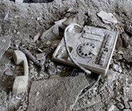 Old phone. Abandoned house hospital old antique telephone asbestos gray grey grays greys Royalty Free Stock Photo