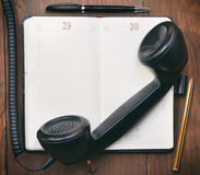 Old phone and address book Royalty Free Stock Images