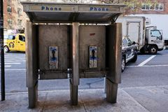 Old phone booth in New York City royalty free stock photos