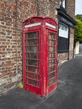 The old phone box. An old phone box showing signs of neglect and rust Royalty Free Stock Photos