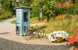 Phone box. Old phone box and bicycle at Skansen, the first open-air museum and zoo, located on the island Djurgarden in Stockholm, Sweden Stock Photos