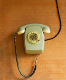 Old phone with a cable on wall Royalty Free Stock Images