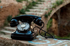 The old phone between the castle's ruins. Royalty Free Stock Photo
