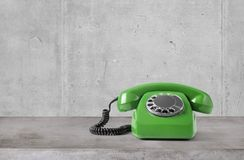 Old phone on concrete table. Vintage telephone on concrete table stock photos
