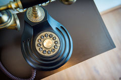 Old phone. On the desk Royalty Free Stock Images