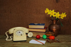 Old phone and flowers Royalty Free Stock Image