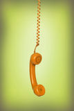 Old phone hanging Stock Photo