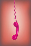 Old phone hanging Royalty Free Stock Photos