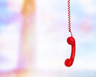 Old phone hanging Stock Photography