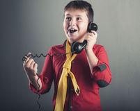 The old phone. Happy kid talking on old phone Royalty Free Stock Photos