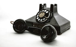 Antique dial phone. An isolated old rotary phone Royalty Free Stock Photo