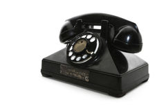 Obsolete dial phone. An isolated old rotary phone Stock Image