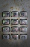 Old phone keypad numbers. Old payphone dirty keypad numbers stock photos